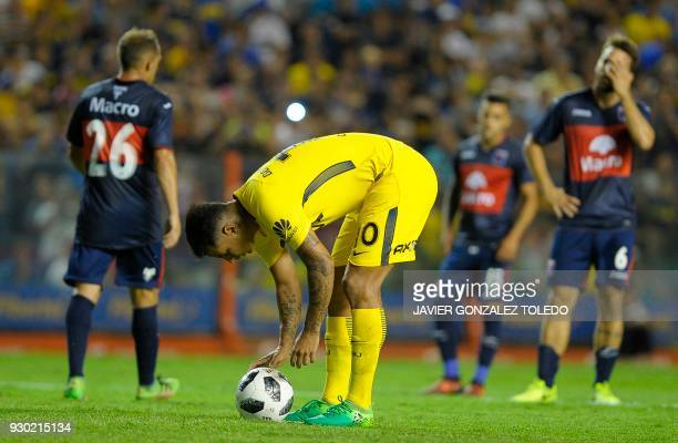 Colombian Boca Juniors' midfielder Edwin Cardona takes a penalty against Tigre during their Argentina First Division Superliga football match at the...