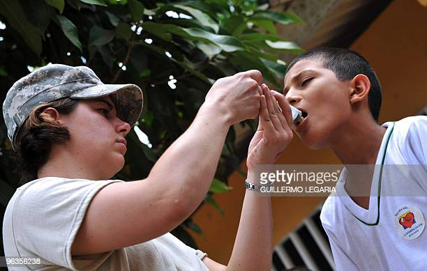 Colombian boy is treated by a US physician on February 2 in La Macarena, Meta departament, Colombia. A health brigade was installed by the US and...