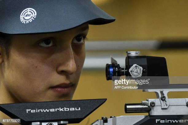 Colombian Camila Osorio competes in the Women's 10m Air Rifle Shooting Finalat the XVIII Juegos Bolivarianos in Cali Colombia on November 13 2017 /...
