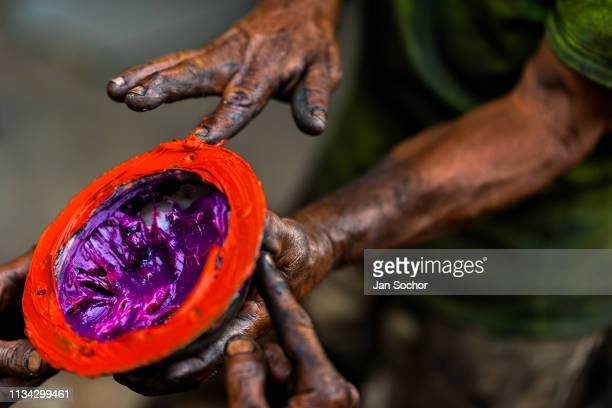 Colombian car mechanics apply different types of lubricant grease on a truck axle cap during the maintenance service in Barrio Triste on April 18...