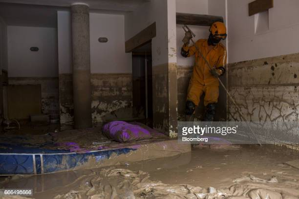 A Colombian Civil Defense worker searches a destroyed home in the Prospero neighborhood of Mocoa Putumayo Colombia on Monday April 3 2017 Torrential...