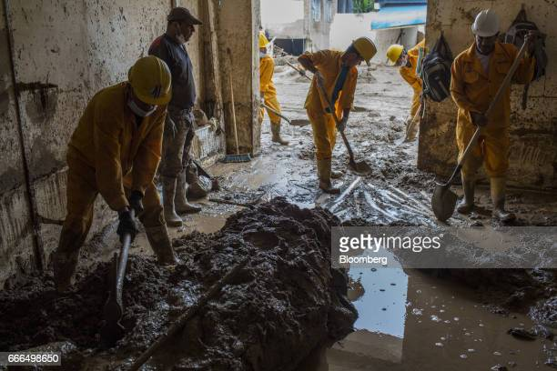 Colombian Civil Defense workers shovel mud from a destroyed home after a landslide in the Prospero neighborhood of Mocoa Putumayo Colombia on Monday...