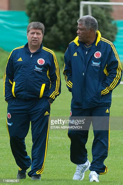 Colombian coach Hernan Dario Gomez talks to the Director of Colombia's national team Francisco Maturana during a training session in Bogota on June...