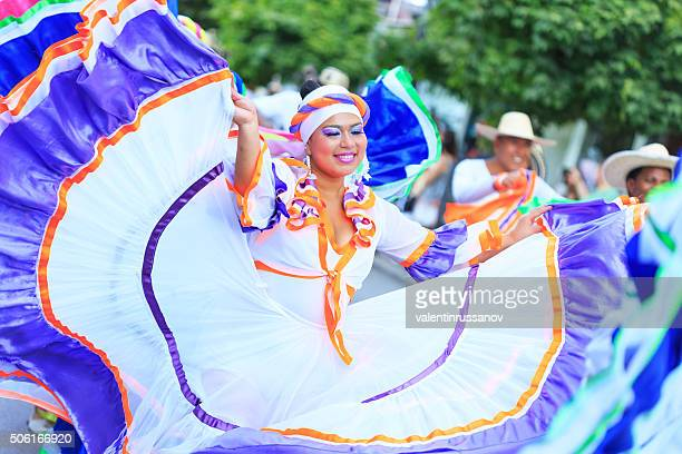 Colombian couples in tradional costumes performing at festival