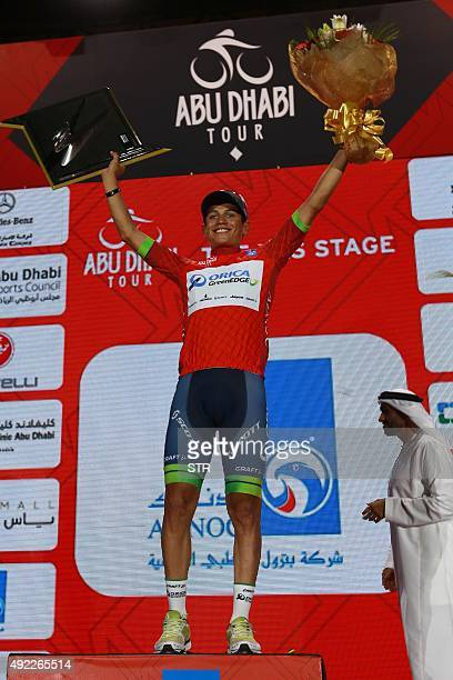 Colombian cyclist Esteban Chaves of Orica GreenEDGE Team celebrates on the podium after winning the Abu Dhabi tour on October 11 2015 AFP PHOTO / STR