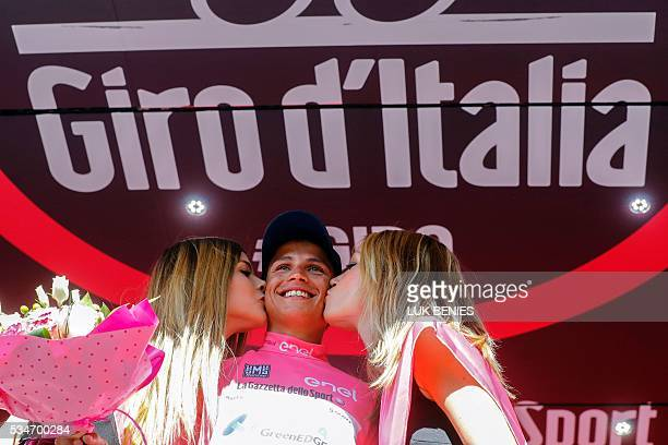 Colombian cyclist Esteban Chaves of Orica GreenEDGE team celebrates the pink jersey of the overall leader on the podium of the 19th stage of the 99th...