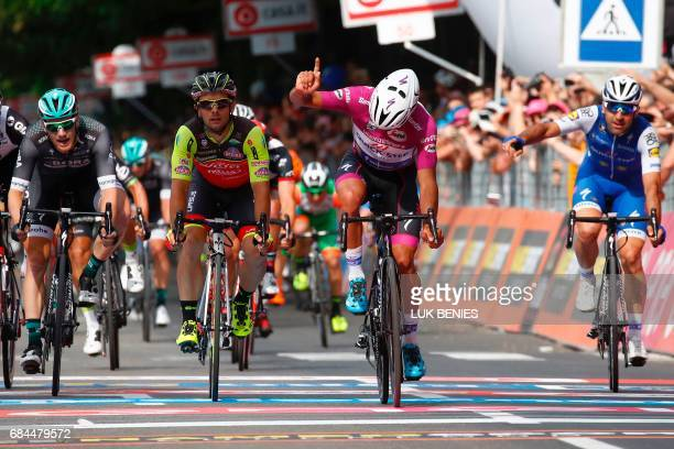 Colombian cyclist Fernando Gaviria from QuickStep Floors reacts as he crosses the finish line to win the 12th stage of the 100th Giro d'Italia Tour...
