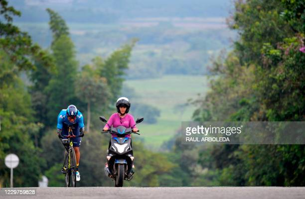 """Colombian cyclist, former soldier Juan Jose Florian, aka """"Mochoman,"""" rides his bicycle along with his wife and trainer Angie Garces during a training..."""
