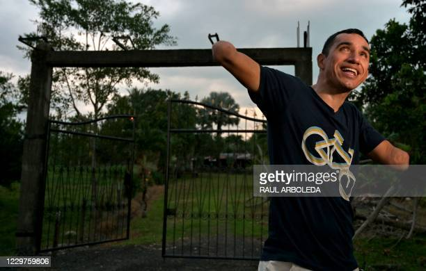 """Colombian cyclist, former soldier Juan Jose Florian, aka """"Mochoman,"""" speaks to AFP during an interview in front of the house where he was recruited..."""