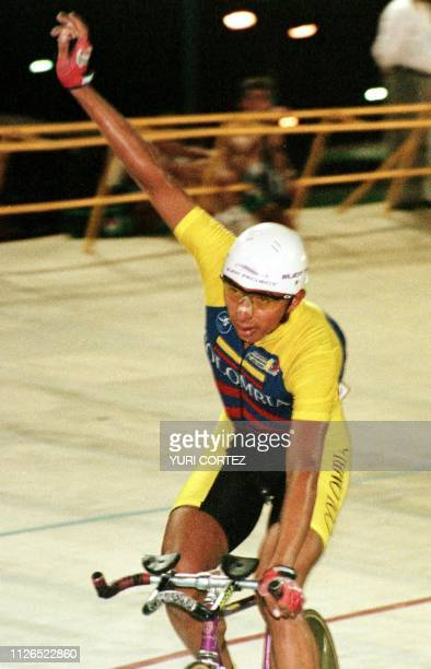 Colombian cyclist Jairo Perez celebrates 11 August in the Pachencho Romero stadium in Maracaibo Venzuela Gonzalez won the 4000 meter individual...