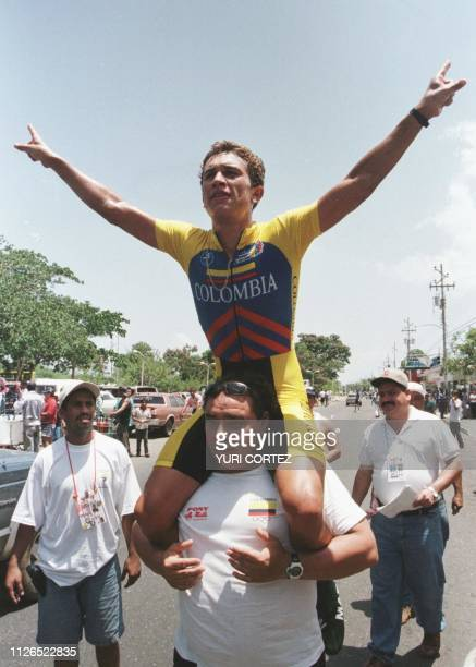 Colombian cyclist Marlon Perez Arango celebrates on the shoulders of his coach after winning the individual againsttheclock 488kilometer competition...
