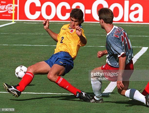 Colombian defender Andres Escobar comes up short as he tried to block the shot of US forward Eric Wynalda during their World Cup first round soccer...