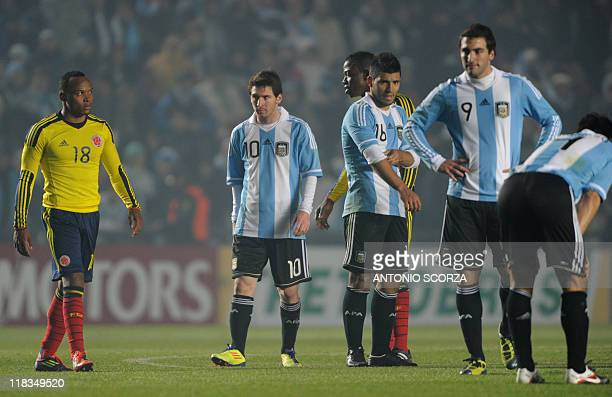 Colombian defender Camilo Zuniga and Argentine forwards Lionel Messi Sergio Aguero and Gonzalo Higuain gesture at the end of their 2011 Copa America...