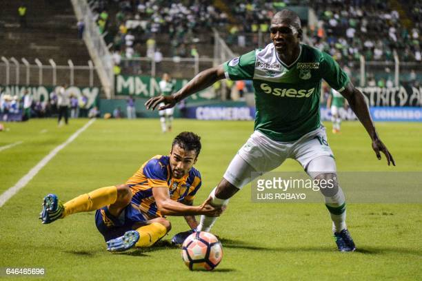 Colombian Deportivo Cali defender German Mera vies for the ball with Paraguayan Sportivo Luqueno forward Adrian Fernandez during their Sudamericana...