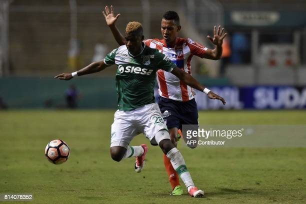 Colombian Deportivo Cali defender Luis Orejuela vies for the ball with Colombian Junior midfielder James Sanchez during their Copa Sudamericana...