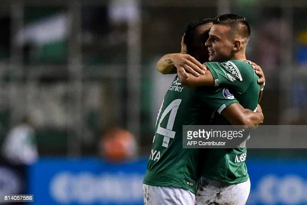 Colombian Deportivo Cali midfielder Nicolas Benedetti celebrates with teammate forward Cesar Amaya a goal against Colombian Junior during their Copa...