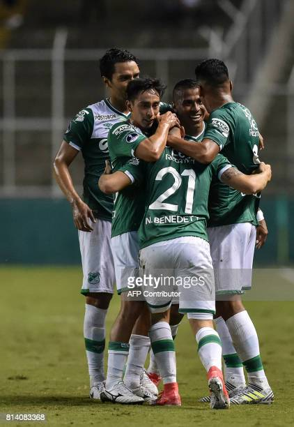 Colombian Deportivo Cali midfielder Nicolas Benedetti celebrates with his teammates after scoring against Colombian Junior during their Copa...