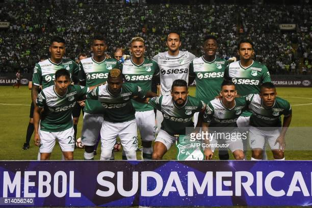 Colombian Deportivo Cali team members pose for a picture before the start of their Copa Sudamericana football match against Colombian Junior at the...