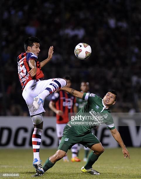 Colombian Deportivo Cali's Robin Ramirez vies for the ball with Paraguay's Cerro Porteno's player Luis Cardozo during their Copa Libertadores...