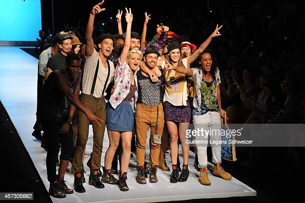 Colombian designer Andres Velez poses for a photo with his models during the Clownaman show as parto of the second day of Cali Exposhow 2014 Fashion...