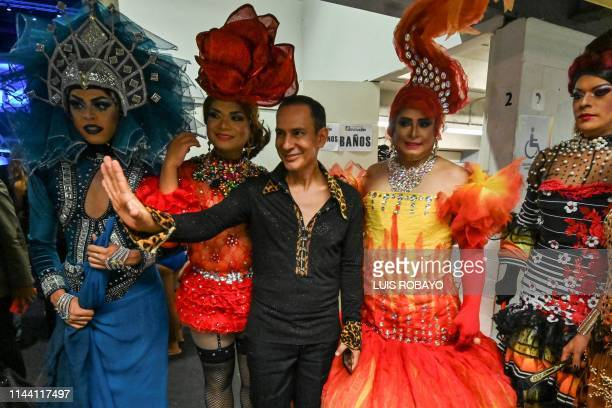 Colombian designer Diego Morales poses for a photo with his models members of the LGBTI community during the Walkway Inclusion fashion show in Cali...