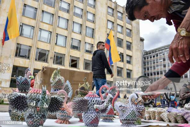 Colombian designer Luis Orlando Ortega arranges handicrafts his handicrafts made with Venezuelan devalued and out of circulation banknotes Bolivares...