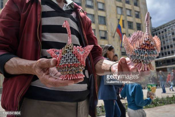 Colombian designer Luis Orlando Ortega shows handicrafts made with Venezuelan devalued and out of circulation banknotes Bolivares Fuertes to be sold...