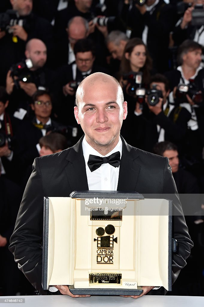 Colombian director Cesar Augusto Acevedo with the Camera d'Or for his film 'La tierra y la sombra' at closing ceremony photocall during the 68th annual Cannes Film Festival on May 24, 2015 in Cannes, France.
