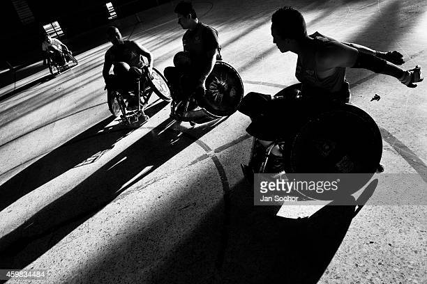 Colombian disabled athletes take part in a wheelchair rugby training at the indoor sporting arena Coliseo on January 29 2013 in Bogota Colombia...