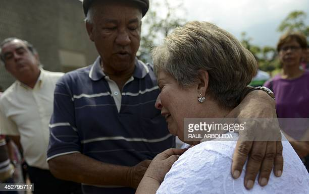Colombian drug lord Pablo Escobar's sister, Luz Maria Escobar , cries at Montesacro cemetery in Medellin, Antioquia department, Colombia on December...