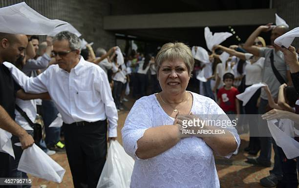 Colombian drug lord Pablo Escobar's sister, Luz Maria Escobar, leaves a church at Montesacro cemetery in Medellin, Antioquia department, Colombia on...