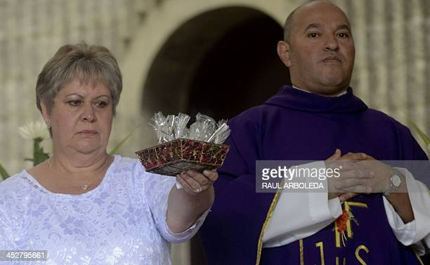Colombian drug lord Pablo Escobar's sister, Luz Maria Escobar , takes part in a mass at Montesacro cemetery in Medellin, Antioquia department,...