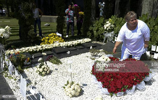 Colombian drug lord Pablo Escobar's sister, Luz Maria Escobar visits his tomb at Montesacro cemetery in Medellin, Antioquia department, Colombia on...