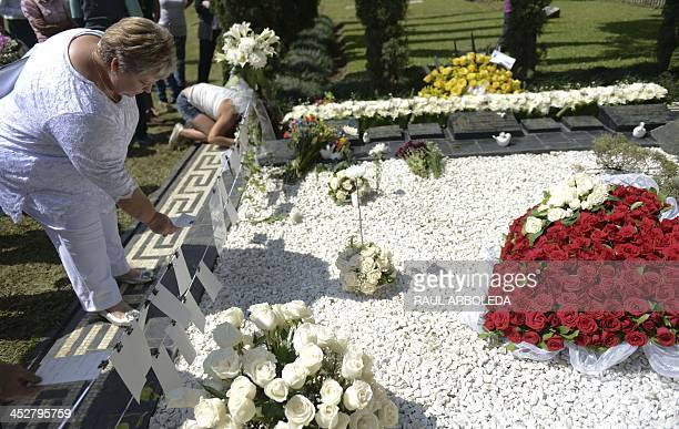 Colombian drug lord Pablo Escobar's sister Luz Maria Escobar visits his tomb at Montesacro cemetery in Medellin Antioquia department Colombia on...
