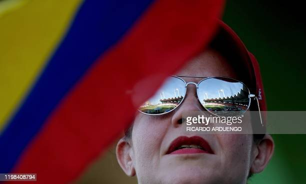 Colombian fan looks on during a game between Colombia and the Dominican Republic during the Caribbean Series baseball tournament at the Hiram Bithorn...