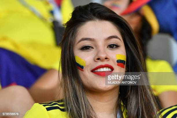 A Colombian fan smiles before the Russia 2018 World Cup Group H football match between Colombia and Japan at the Mordovia Arena in Saransk on June 19...