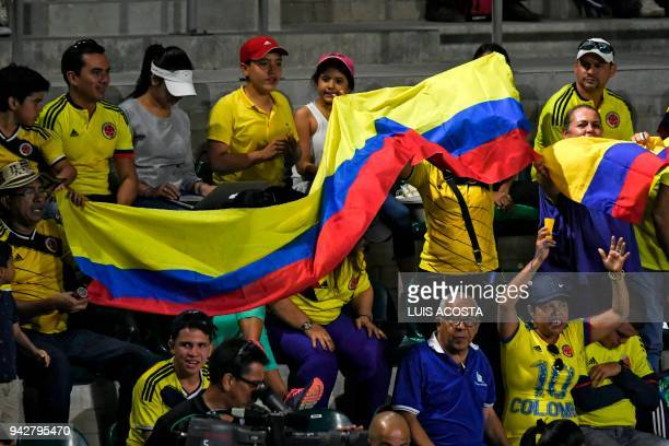 Colombian fans cheer during a Davis Cup Americas Zone Group I second round singles tennis match between Colombian tennis player Daniel Galan and...