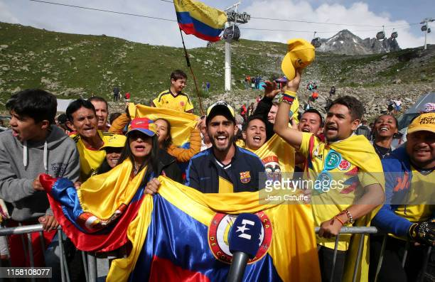 Colombian fans of yellow jersey Egan Bernal Gomez of Colombia and Team Ineos celebrate following stage 20 of the 106th Tour de France 2019, a stage...