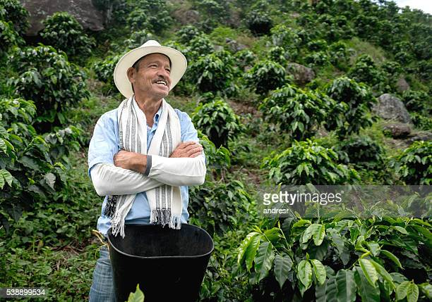 Colombian farmer working at a coffee farm