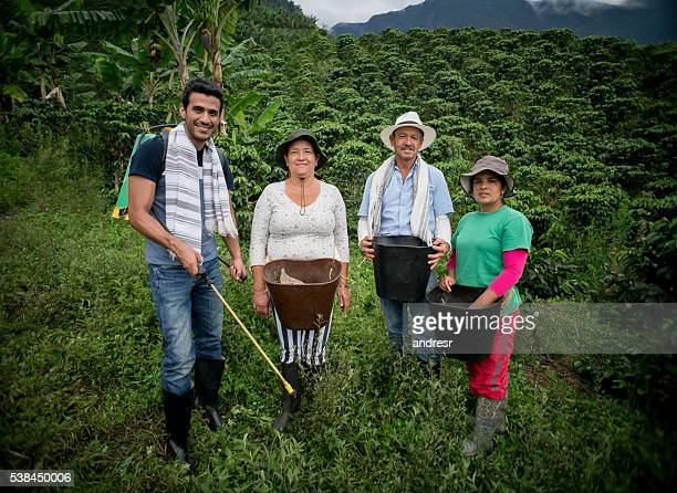 Colombian farmers working at a coffee farm