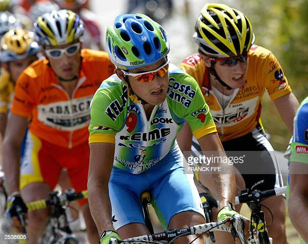 Colombian Felix Cardenas Spain's Oscar Sevilla and compatriot Isidro Nozal rides during the 19th stage of the 58th Tour of Spain cycling race between...