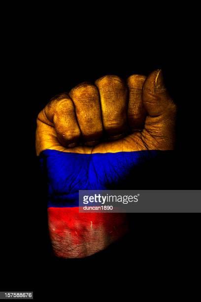 puño colombiano - bandera colombiana fotografías e imágenes de stock