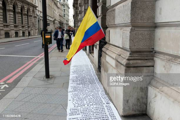 Colombian flag on top of the 50m long banner on the pavement outside Gibson Hall with the names of more than 700 social leaders who have been killed...