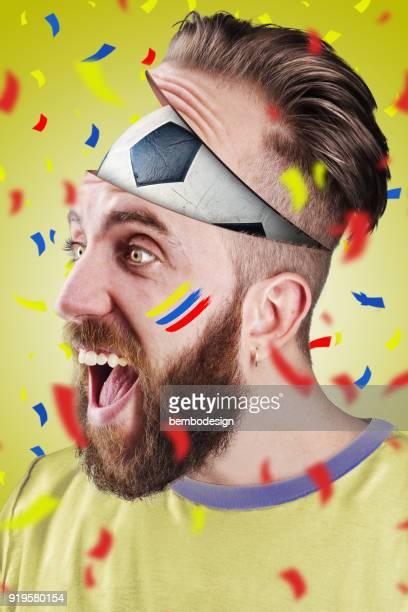 Colombian football fan with football inside the head