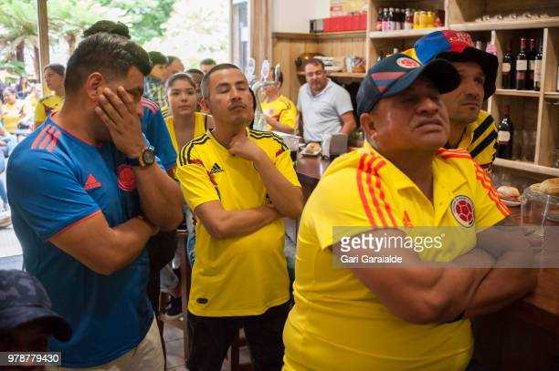 Colombian football fans watch their national team's Russia 2018 World Cup Group H match against Japan in a bar on June 19 2018 in Irun Spain