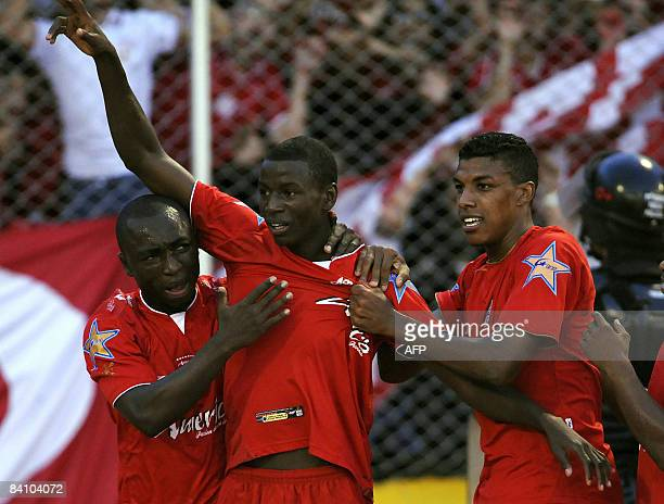 Colombian footballer Adrian Ramos of Cali's America celebrates with his teammates after scoring against Deportivo Medellin during the Colombian...