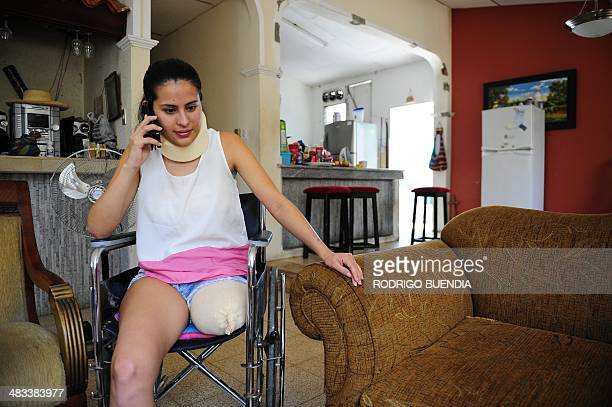 Colombian footballer Yady Fernandez speaks on the phone during an interview with AFP in Puerto Hondo Ecuador 20 Km away from Guayaquil on April 5...