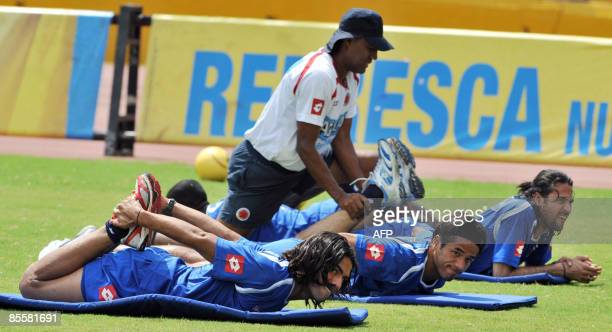 Colombian footballers Falcao Garcia Fabian Vargas and Mario Yepes stretch during a training session at Pascual Guerrero Stadium in Cali Valle del...