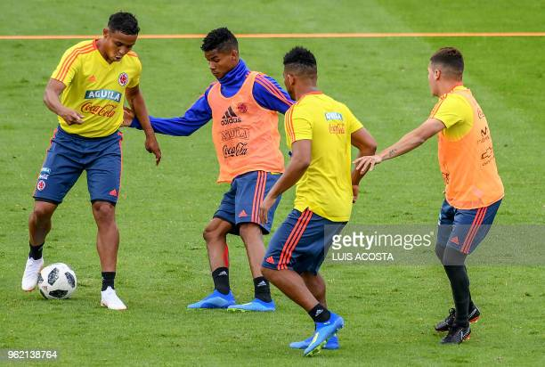 Colombian footballers Luis Muriel Juan Fernando Quintero and Frank Fabra take part in a training session at El Campin stadium in Bogota on May 24 2018