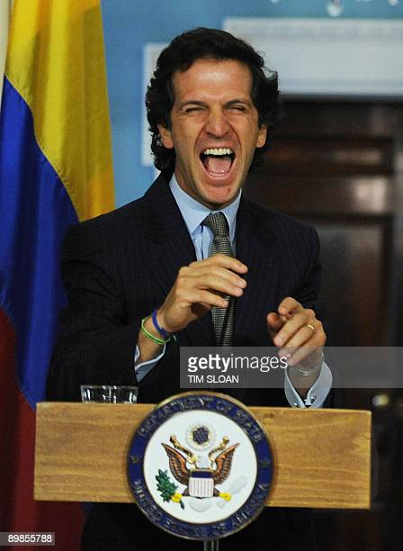 Colombian Foreign Minister Dr Jaime Bermudez Merizalde laughs after a joke by US Secretary of State Hillary Clinton during a press conference at the...